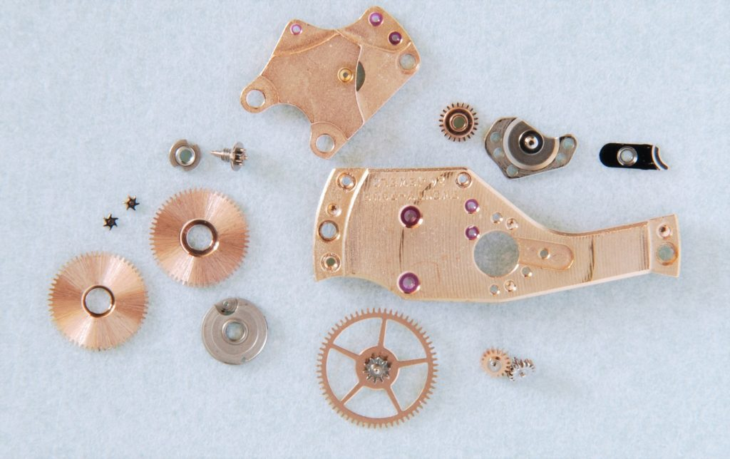Watchmaker showing typical watch service - Omega Seamaster 60m, calibre 565