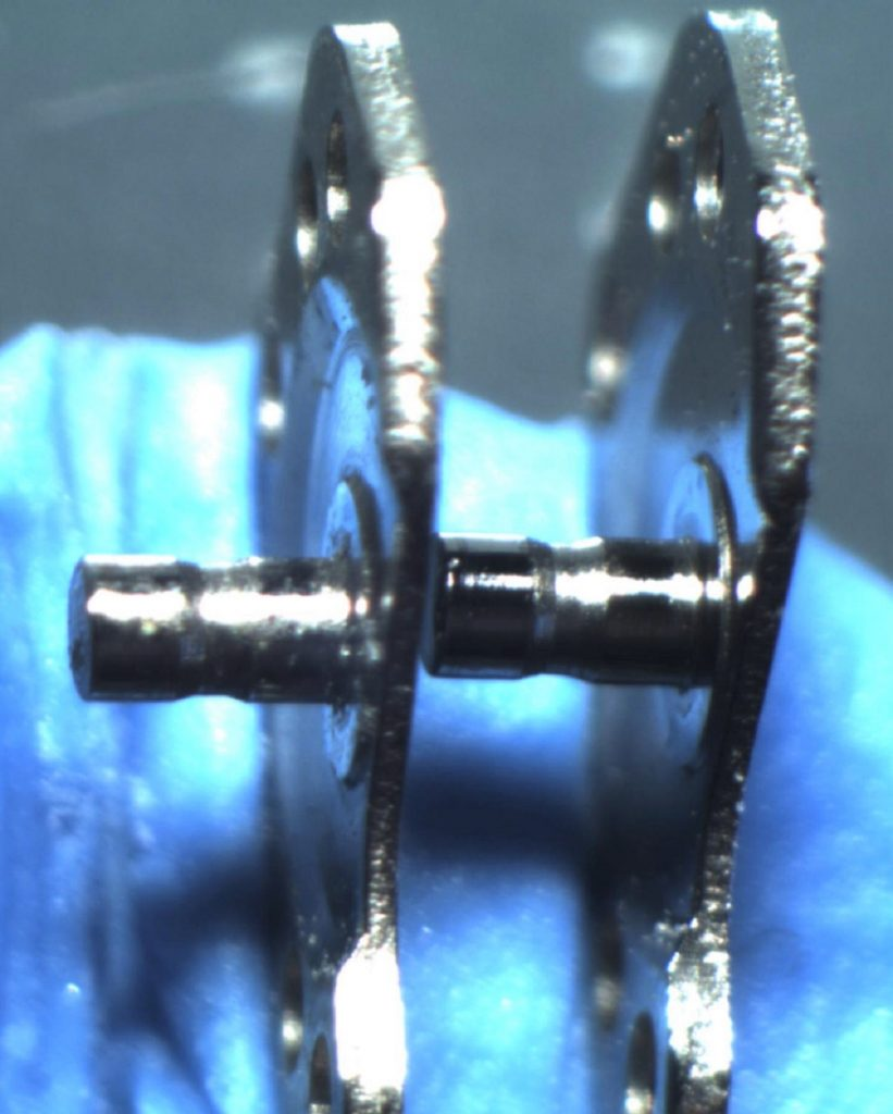 Watchmaker showing service microscope inspection