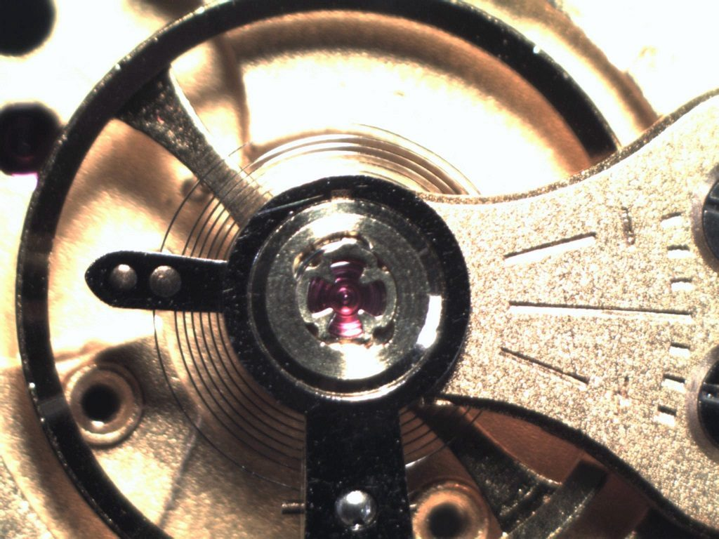 Watchmaker showing performance and positional variation improvement on Smiths vintage watch