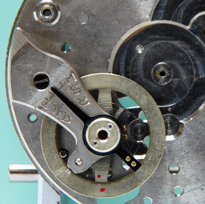 Watchmaker showing balance staff replacement