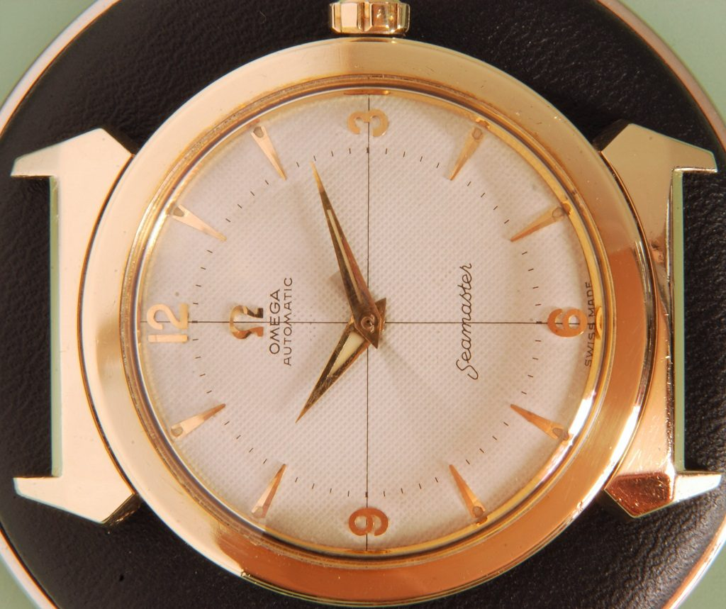 Watchmaker showing application of luminous material on Omega vintage watch