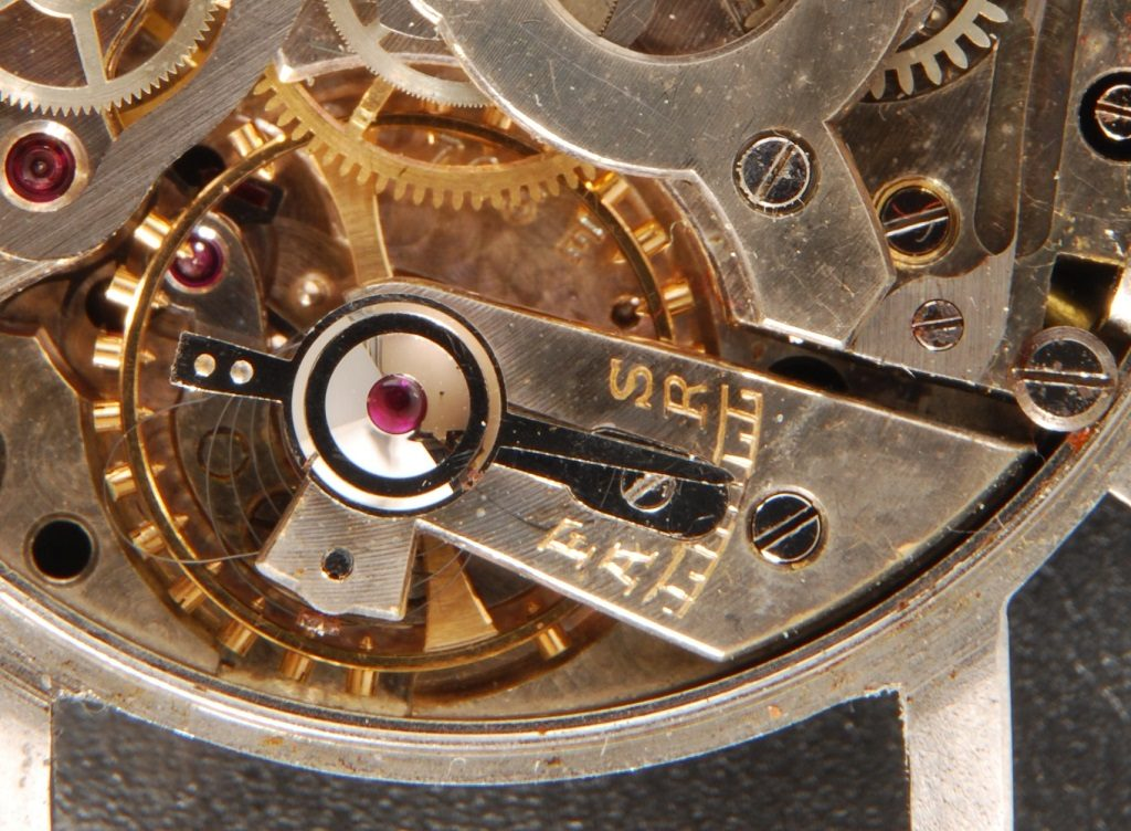 Watchmaker showing recovery of damaged hairspring on Eterna vintage watch