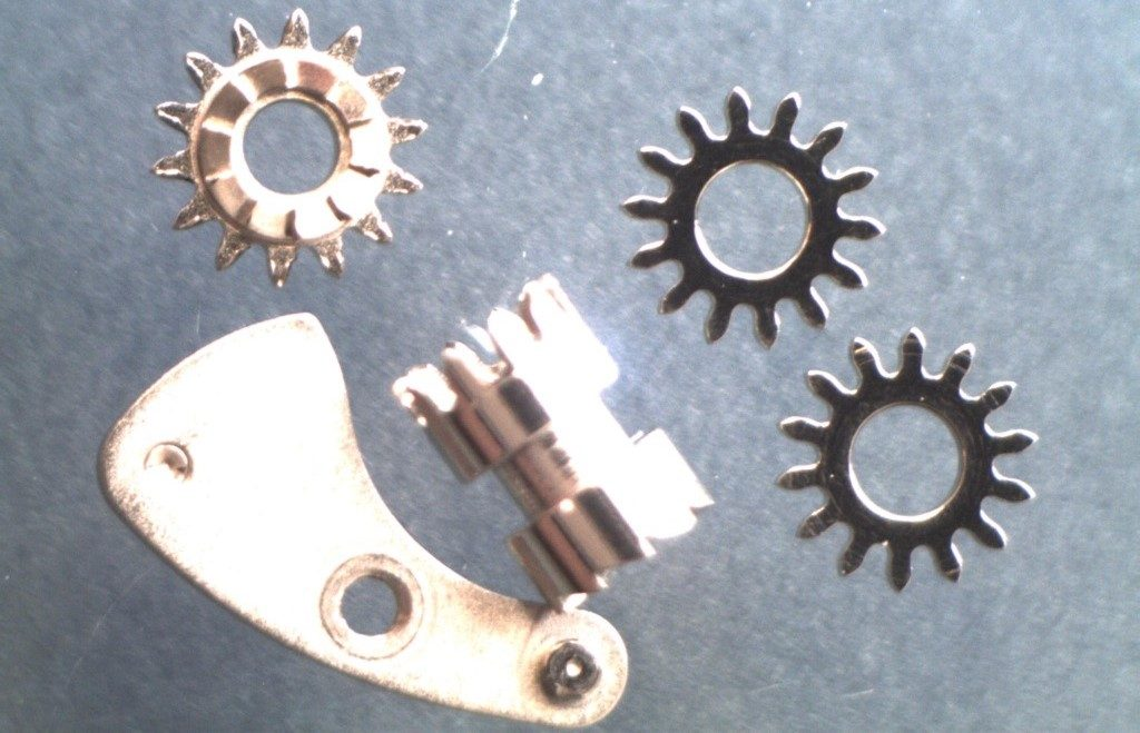 UK watchmaker showing service of Omega Speedmaster - review of keyless work parts