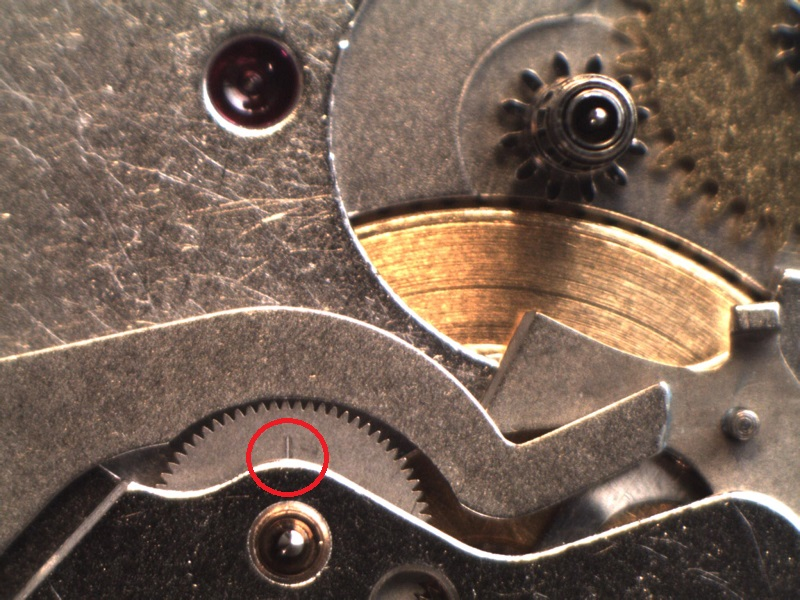 UK watchmaker showing service of Omega Speedmaster - dial side showing hour chrono creep check