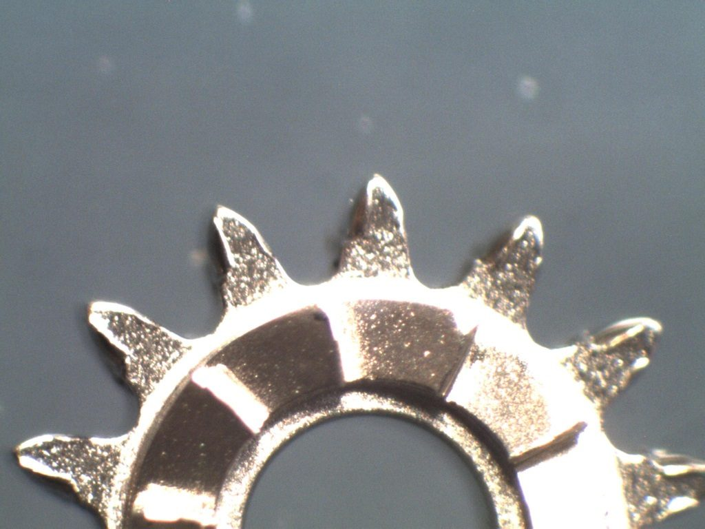 UK watchmaker showing service of Omega Speedmaster - comparison of new to damaged winding pinion