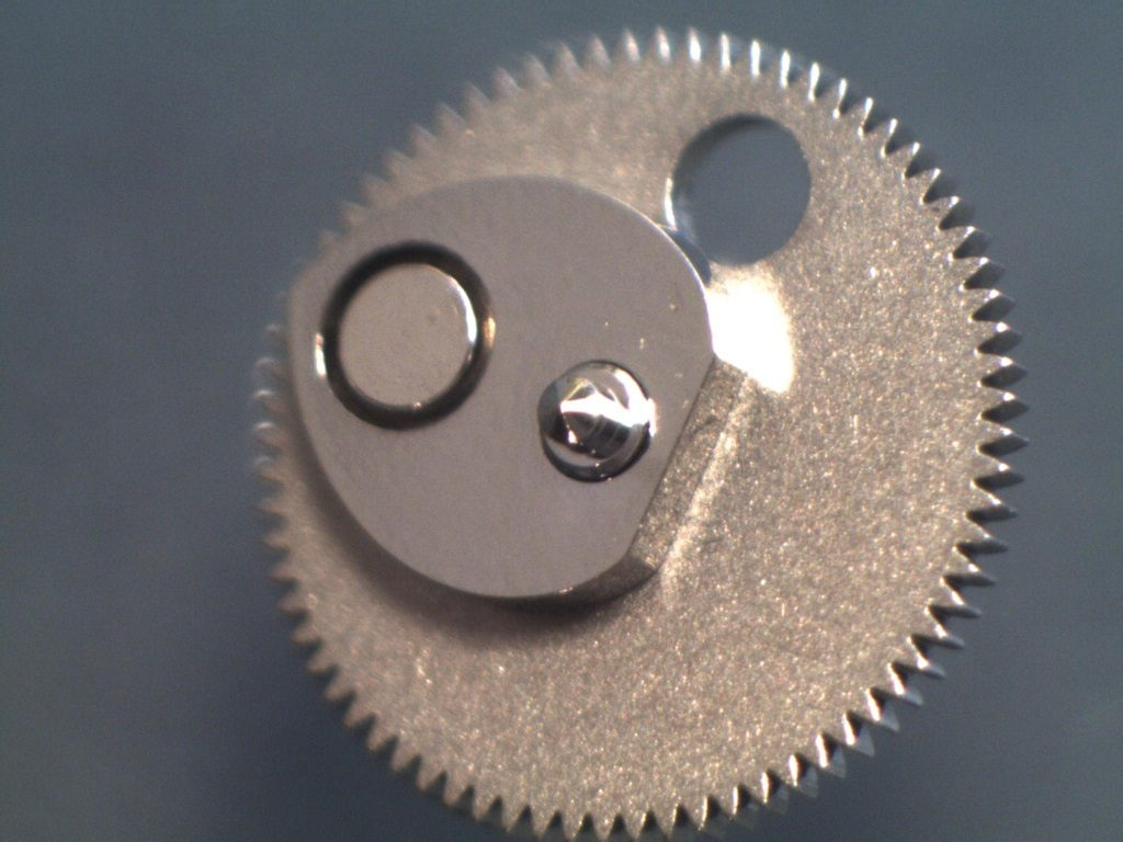 UK watchmaker showing service of Omega Speedmaster - review of hour recorder runner