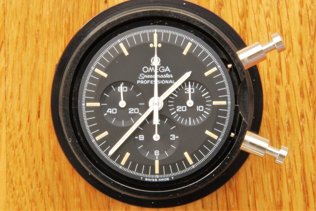 UK watchmaker showing service of Omega Speedmaster - dial and hands review