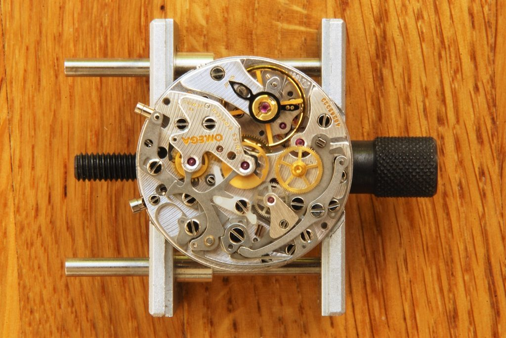 UK watchmaker showing service of Omega Speedmaster - review of top side components
