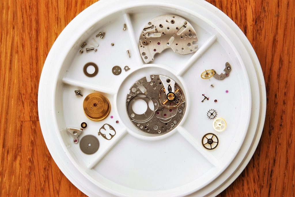 UK watchmaker showing service of Omega Speedmaster - movement parts after cleaning