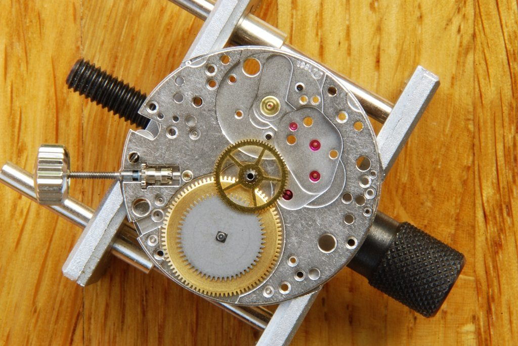UK watchmaker showing service of Omega Speedmaster - second wheel fitted
