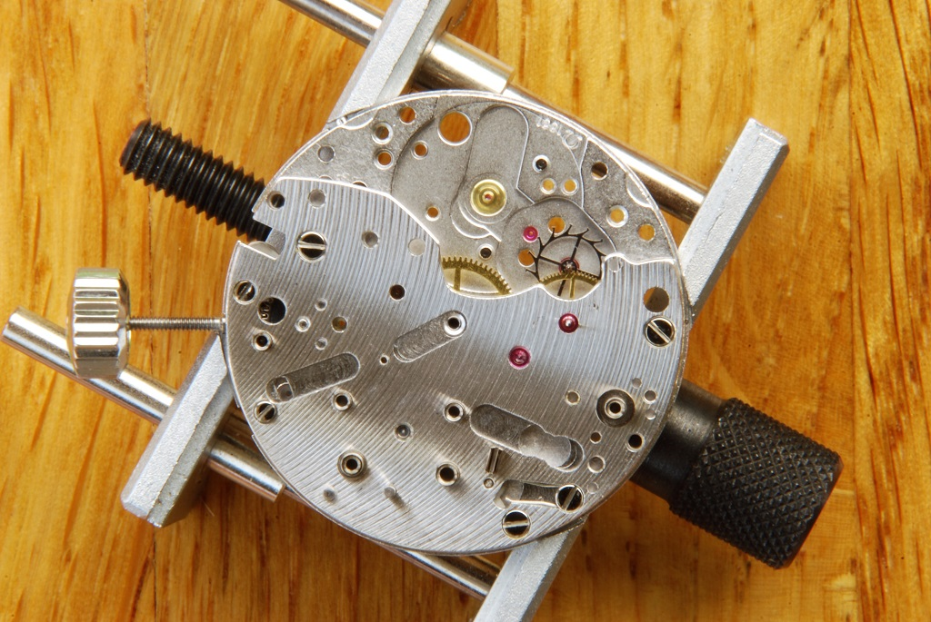 UK watchmaker showing service of Omega Speedmaster -fitting of escape wheel