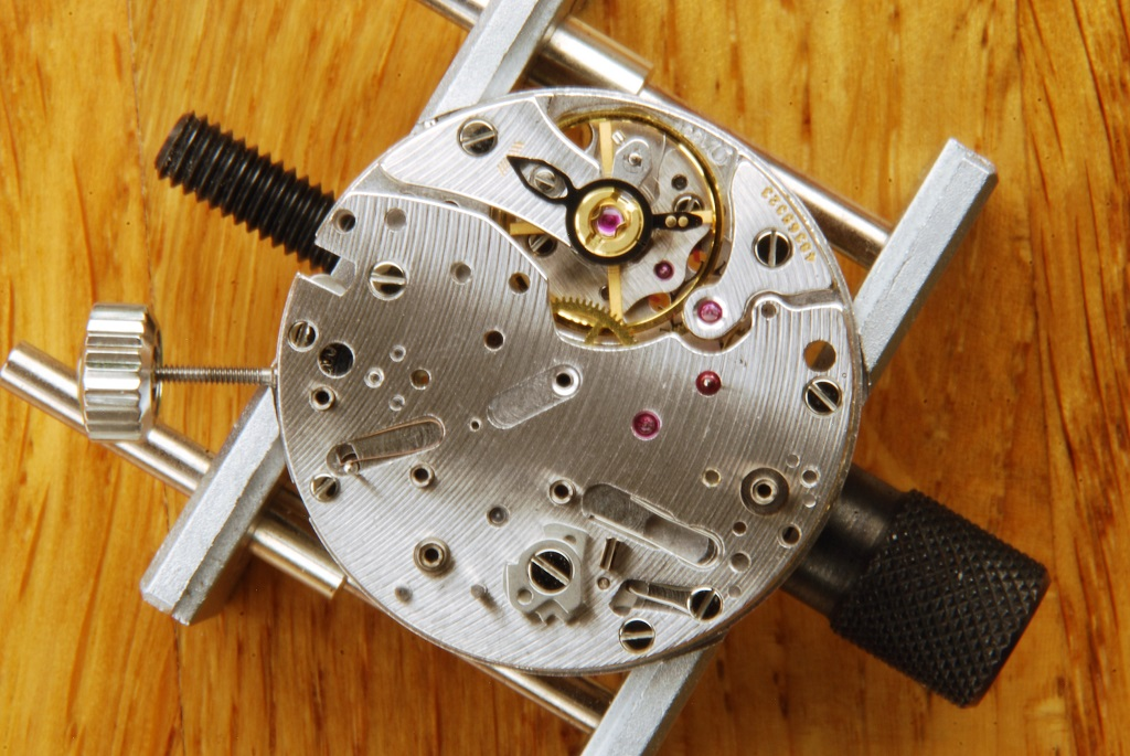 UK watchmaker showing service of Omega Speedmaster - operating cams fitted