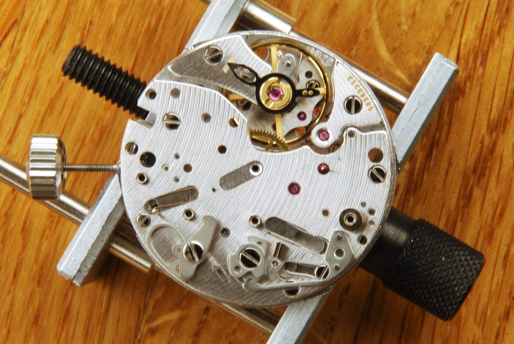UK watchmaker showing service of Omega Speedmaster - operating lever fitted