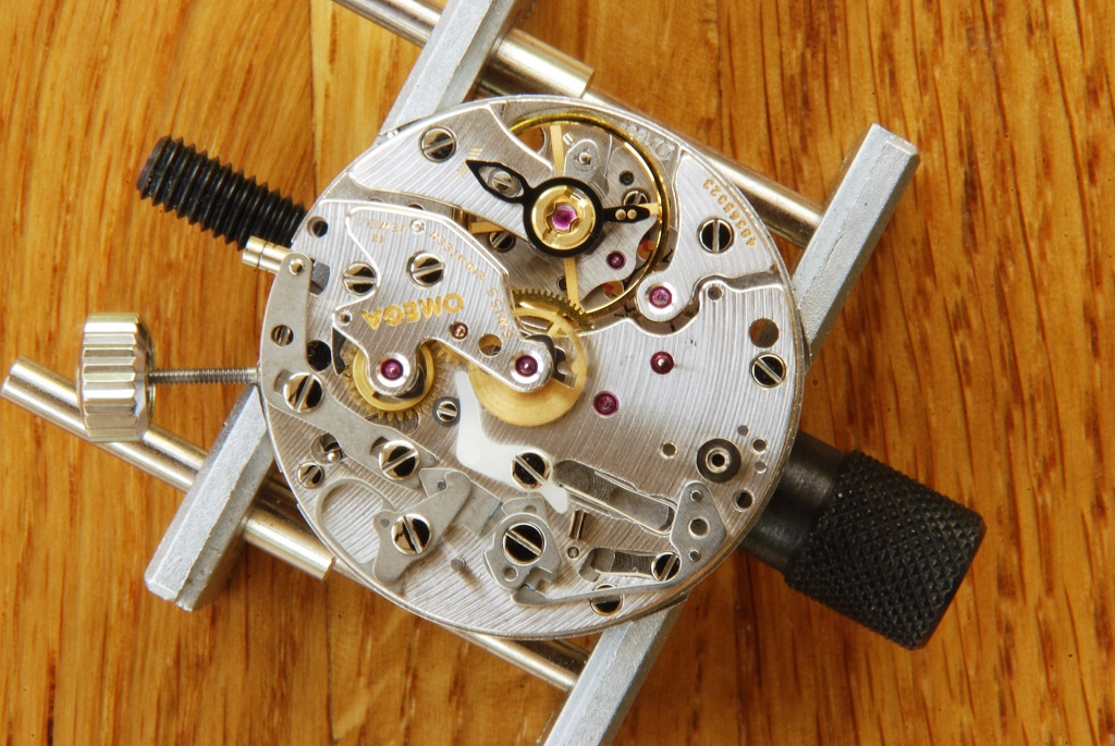 UK watchmaker showing service of Omega Speedmaster - chronograph brake fitted