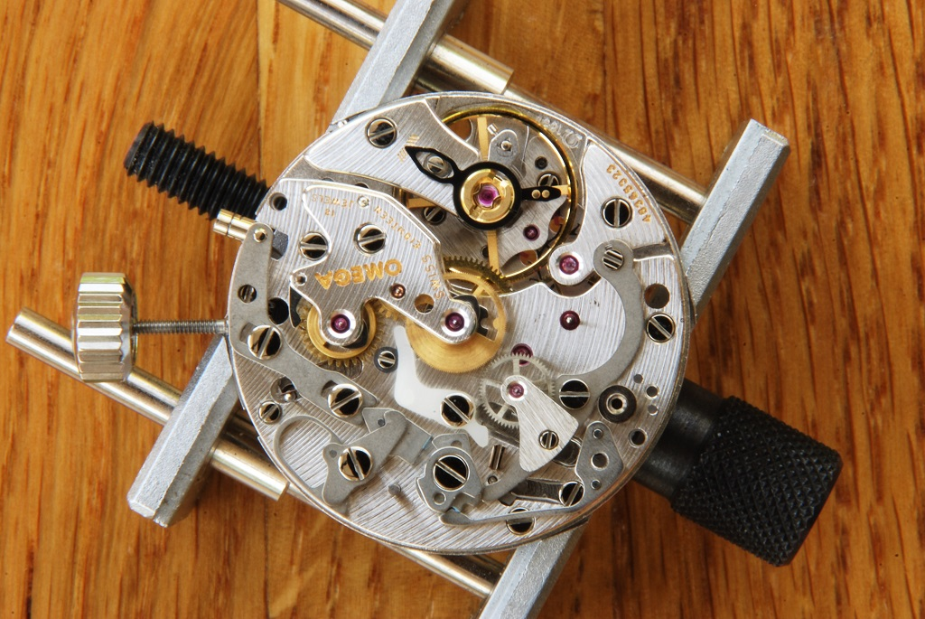 UK watchmaker showing service of Omega Speedmaster - coupling yoke fitted