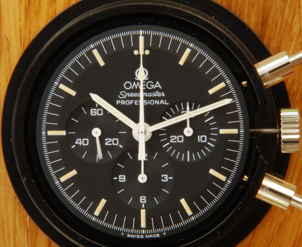 UK watchmaker showing service of Omega Speedmaster - dial side showing dial and hands fitted
