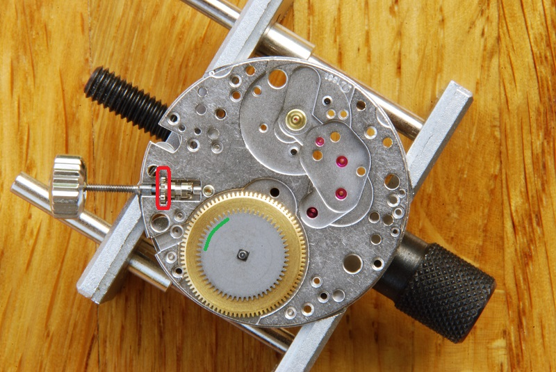 UK watchmaker showing service of Omega Speedmaster - barrel and winding pinion